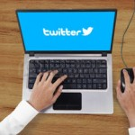 45146651-jakarta-september-08-2015-unique-perspective-of-hands-using-laptop-computer-with-twitter-logo-on-the